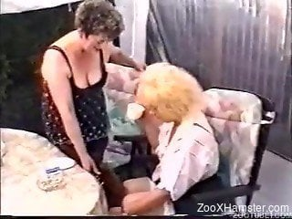 Mature woman gets tiny dog to lick her pussy and ass