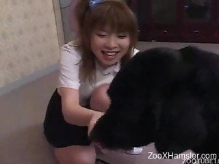 Japanese beauty in white fucks a dog, gets thoroughly creampied