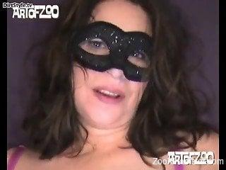 Masked babe enjoying hardcore sex with a kinky dog