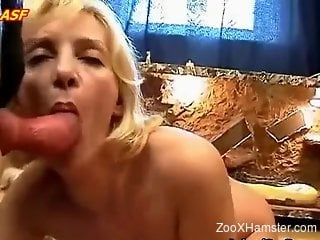 Flexible blondie with a body sucking on a dog's cock