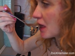 Redheaded woman gets at her home and she is filmed