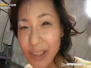 Helpless Japanese MILF getting licked by dogs