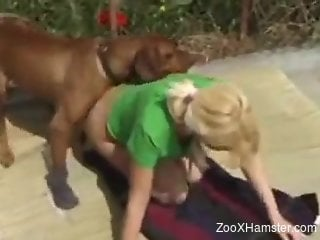 Energized blonde bends ass to fuck with the dog