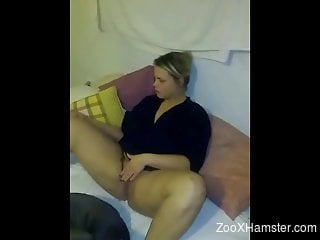 Zoophilic blonde looks bored while dog licks her puss